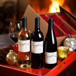 Wine studio photography for holiday marketing by Jason Tinacci
